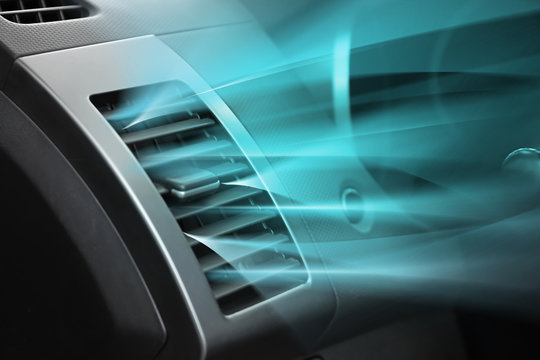 Switched on conditioner with flow of cold air in car
