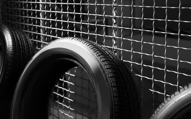 Car tire near grate fence indoors