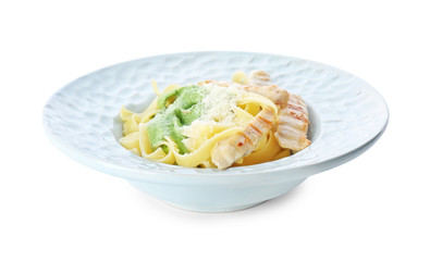 Delicious pasta with chicken on plate against white background