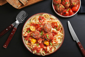 Delicious pasta with meat balls and tomato sauce on plate