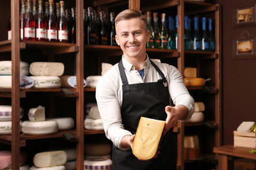 Business owner with cheese in his store