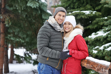 Portrait of happy loving couple in winter park
