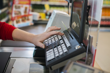 Typing to the cashier at the supermarket