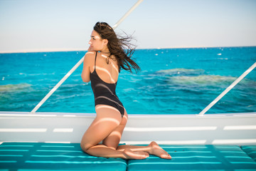 Young sexy woman relax on yacht in sea. Beautiful seascape