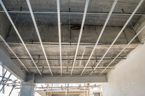 Install metal frame for plaster board ceiling at house under ...