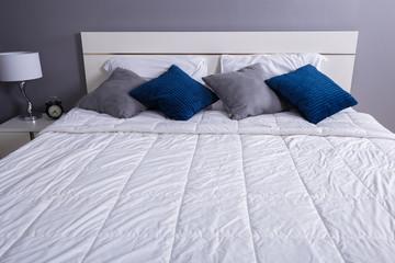 bed in bedroom in home