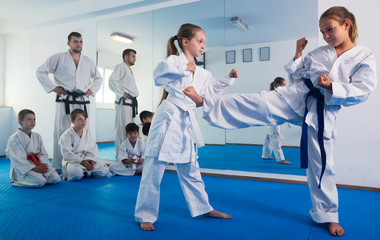 Girls training during karate class