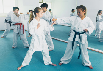 Children training in pairs