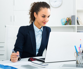 Portrait of successful businesswoman in office.