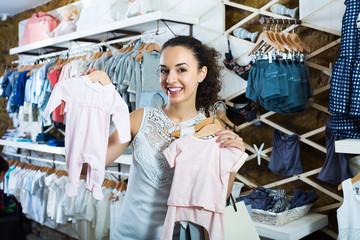 Woman buying baby sleep suit