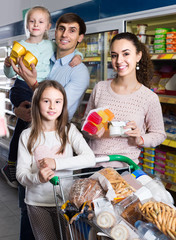 customers with children selecting sweet dairy products in hypermarket