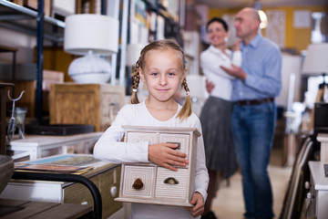 girl with curbstone in furniture store