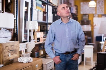 Businessman choosing home furniture