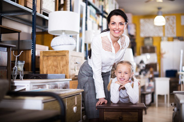 Woman with girl in furniture store