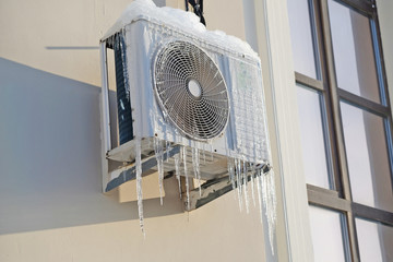 air conditioning on the wall and icicles