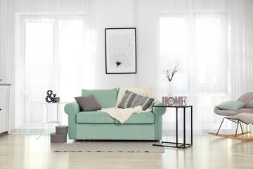 Living room interior with comfortable mint couch