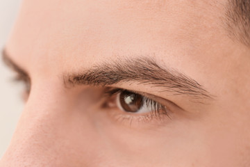 Young man with beautiful eyebrows, closeup