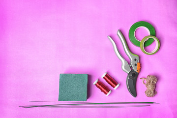 Florist equipment on color background