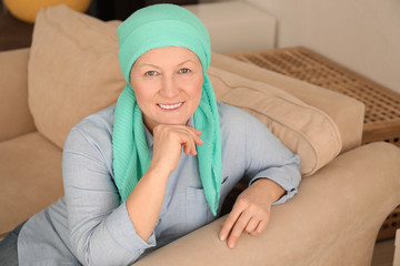 Mature woman with cancer in headscarf indoors