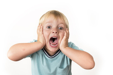 portrait of 3 years old little blond kid with mouth open screaming surprised or scared holding his head with his small hands isolated on white