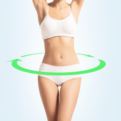 Young, sporty, fit and beautiful girl isolated on white. Healthy eating, dieting and nutrition concept.