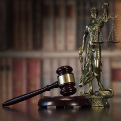 Law and Justice concept. Law books on background