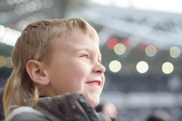 little boy soccer fan at the stadium
