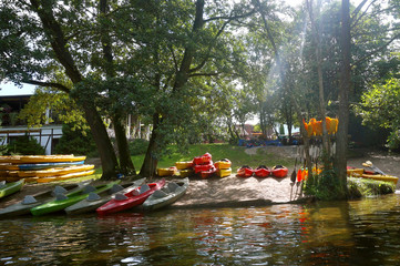 tourist base of kayaks and canoes, summer adventure kayak, rafting to canoe