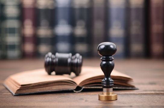 Notary seal and Judge Gavel on the wooden background, Notarized document concept, Legality concept.