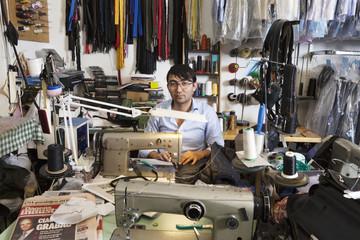 Man at sewing station