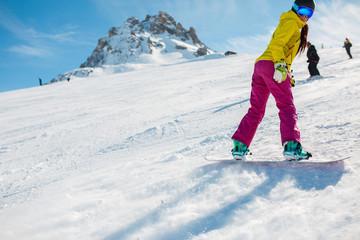 Photo of athlete snowboarding on snowy slope