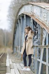 Teenage girl on bridge in Mjolby, Sweden