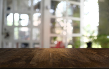 Empty wooden table in front of abstract blurred background of coffee shop . can be used for display or montage your products.Mock up for display