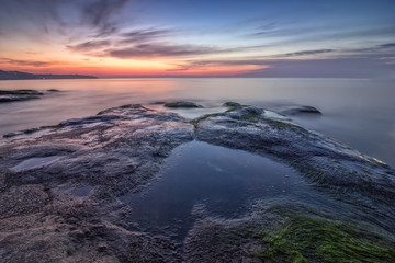 Sea heart. Magnificent sea sunrise at the rocky coast near Varna, Bulgaria