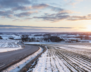 Rural road during winter in Skane, Sweden