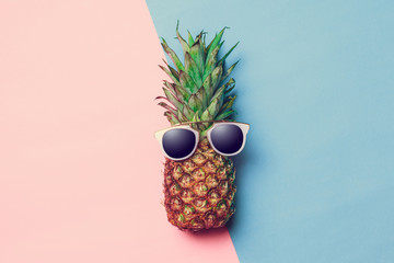 pineapple on colored paper with glasses