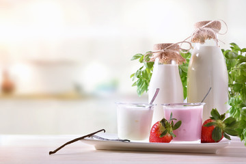 Strawberry and natural yogurt on wooden table front