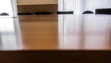 Blurred background of a business wooden table