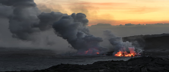 """Pele's Midwife""  A lone hiker takes in the view of lava pouring into the ocean on Hawaii's Big Island."