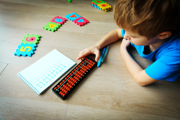 little boy learning numbers, mental arithmetic, abacus