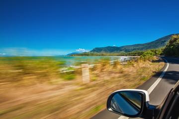 Road trip with motion blur along Ellis Beach near Palm Cove and Cairns, Australia