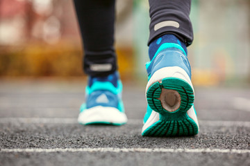 Cropped shot from behind of a woman's running shoes.