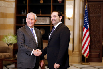 Lebanon's Prime Minister Saad al-Hariri shakes hands with U.S. Secretary of State Rex Tillerson at the governmental palace in Beirut