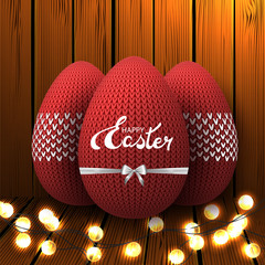 "Red knitted egg with a bow and garland on a wooden background. Celebratory banner. Festive Inscription of the lettering ""Happy Easter"". Vector."