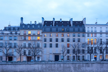 Facades of apartment buildings on Ile Saint Louis, Paris, France