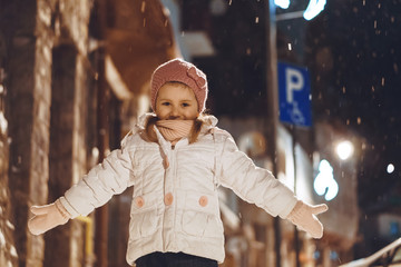 Girl in Street in Evening