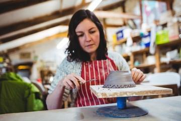 Focused woman working at workshop