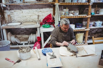 Focused man working at workshop