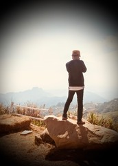 Male photographers are shooting beautiful mountain scenery.