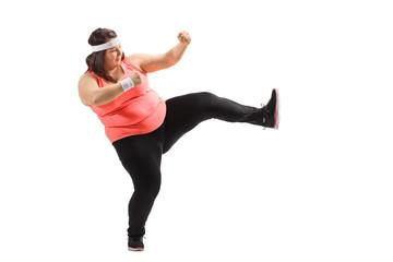 Overweight woman kicking